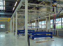 Overhead Monorail System with shifting bridge in a painting plant with pneumatic swivels